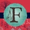 This is the Flourishing Fern F Logo in front of a Pink Background, blue banner and signature blue tree in the background